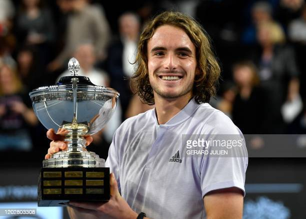 Greece's Stefanos Tsitsipas kisses poses the trophy after winning the ATP Open 13 Provence tennis tournament in Marseille southeastern France on...