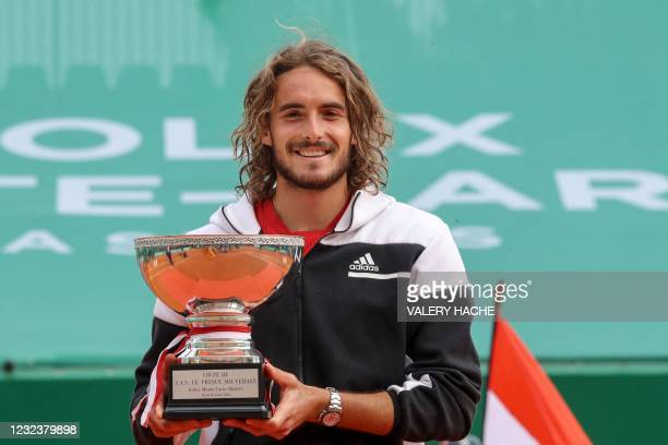 Greece's Stefanos Tsitsipas poses for pictures with the trophy after winning the final singles match against Russia's Andrey Rublev on day nine of...