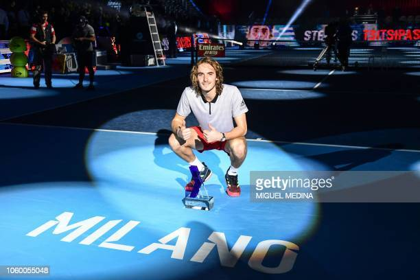 Greece's Stefanos Tsitsipas poses with his trophy after defeating Australia's Alex De Minaur to win the men's final of the Next Generation ATP Finals...