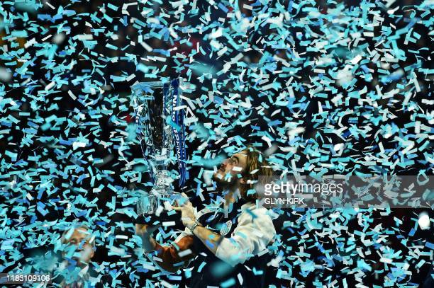 TOPSHOT Greece's Stefanos Tsitsipas poses with the winner's trophy after winning the men's singles final match on day eight of the ATP World Tour...