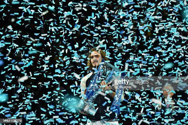 TOPSHOT Greece's Stefanos Tsitsipas poses with the winner's trophy to after the men's singles final match on day eight of the ATP World Tour Finals...