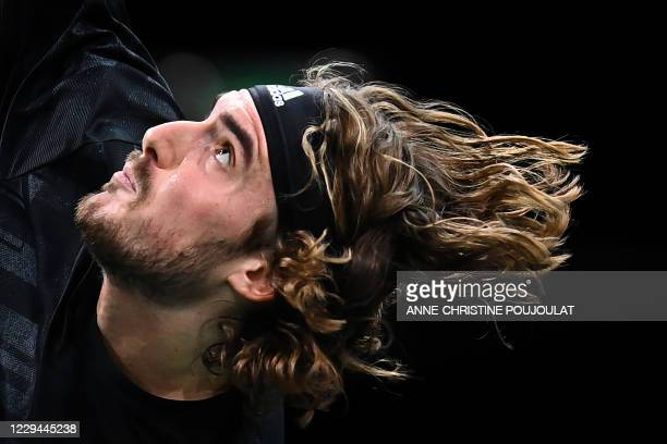 Greece's Stefanos Tsitsipas reacts as he serves the ball to France's Ugo Humbert during their men's singles second round tennis match on day 2 at the...