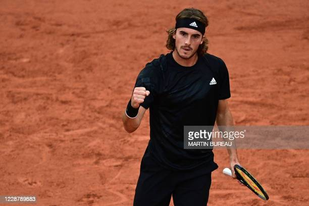 Greece's Stefanos Tsitsipas reacts during his men's singles first round tennis match against Spain's Jaume Munar at the Suzanne Lenglen court on Day...