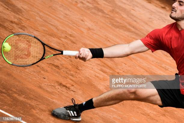 Greece's Stefanos Tsitsipas returns a forehand to Italy's Matteo Berrettini during their match of the Men's Italian Open at Foro Italico on May 13,...