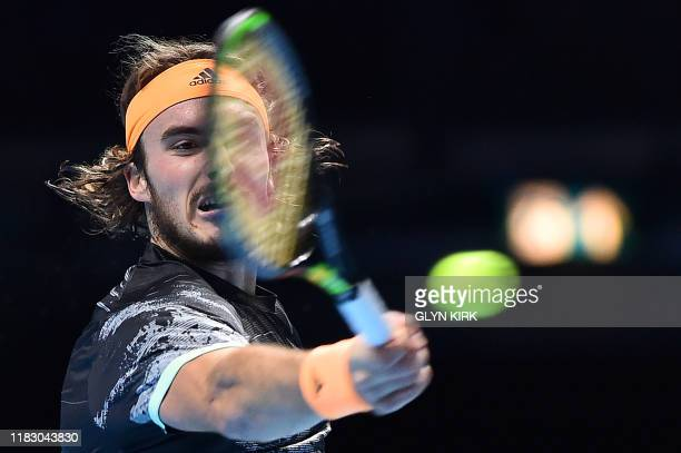 TOPSHOT Greece's Stefanos Tsitsipas returns against Austria's Dominic Thiem during the men's singles final match on day eight of the ATP World Tour...