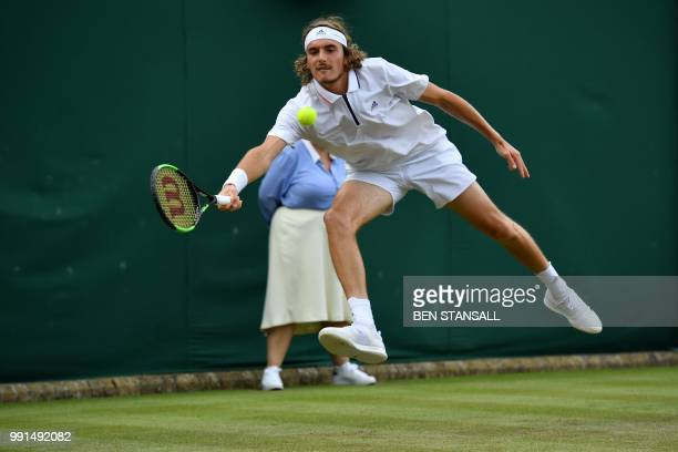 Greece's Stefanos Tsitsipas returns against US player Jared Donaldson during their men's singles second round match on the third day of the 2018...