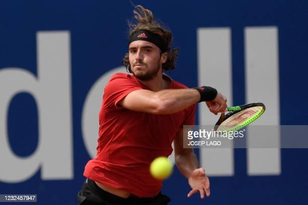 Greece's Stefanos Tsitsipas returns the ball to Australia's Alex De Minaur during their ATP Barcelona Open tennis tournament singles match at the...