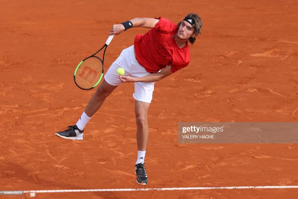 Greece's Stefanos Tsitsipas returns the ball to Canada's Denis Shapovalov during their round of 64 tennis match at the Monte-Carlo ATP Masters Series Tournament, on April 16, 2018 in Monaco. /