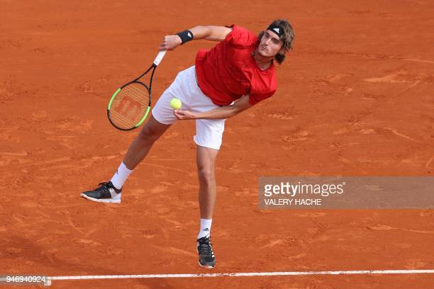 Greece's Stefanos Tsitsipas returns the ball to Canada's Denis Shapovalov during their round of 64 tennis match at the MonteCarlo ATP Masters Series...