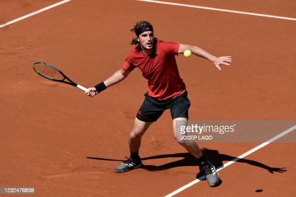 Greece's Stefanos Tsitsipas returns the ball to Canada's Felix Auger Aliassime during their ATP Barcelona Open tennis tournament singles...