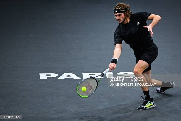 Greece's Stefanos Tsitsipas returns the ball to France's Ugo Humbert during their men's singles second round tennis match on day 2 at the ATP World...