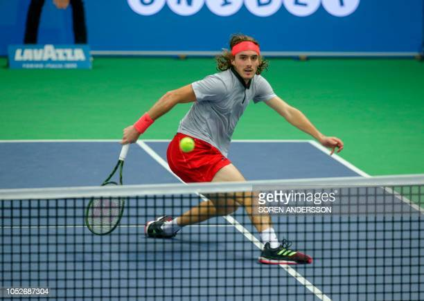 Greece's Stefanos Tsitsipas returns the ball to Latvia's Ernests Gulbis during their final at the ATP Stockholm Open tennis tournament on October 21...