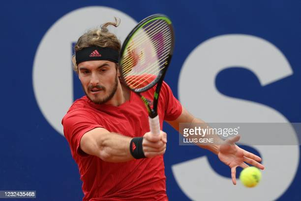 Greece's Stefanos Tsitsipas returns the ball to Spain's Jaume Munar during their ATP Barcelona Open tennis tournament singles match at the Real Club...
