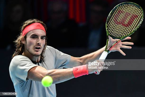 Greece's Stefanos Tsitsipas returns to Australia's Alex De Minaur during the men's final of the Next Generation ATP Finals in Milan on November 10...