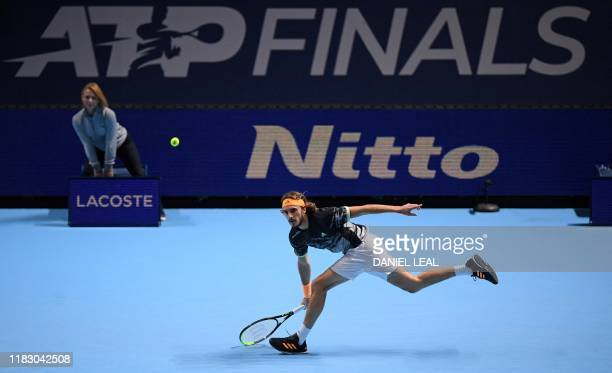 Greece's Stefanos Tsitsipas serves against Austria's Dominic Thiem during the men's singles final match on day eight of the ATP World Tour Finals...
