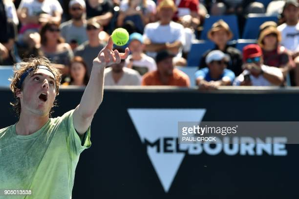 Greece's Stefanos Tsitsipas serves against Canada's Denis Shapovalov during their men's singles first round match on day one of the Australian Open...
