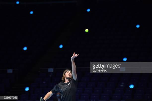 Greece's Stefanos Tsitsipas serves against Russia's Andrey Rublev in their men's singles round-robin match on day three of the ATP World Tour Finals...