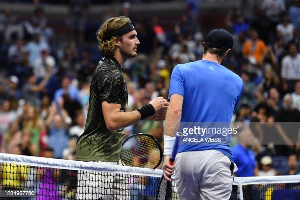 Greece's Stefanos Tsitsipas shakes hands with Britain's Andy Murray after winning their 2021 US Open Tennis tournament men's singles first round...