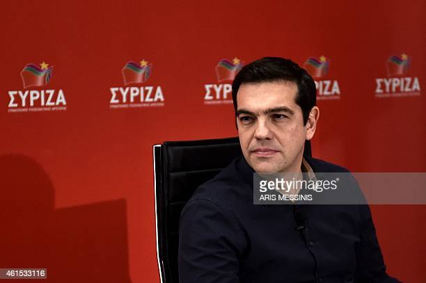 Greece's Syriza party leader Alexis Tsipras attends an interview by the newspaper Aygi and answers questions by Twitter users in Athens on January 14...