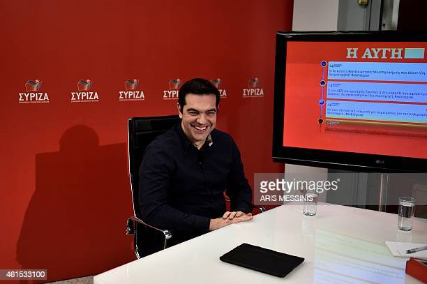 Greece's Syriza party leader Alexis Tsipras smiles during an interview by the newspaper Aygi and answers questions by Twitter users in Athens on...