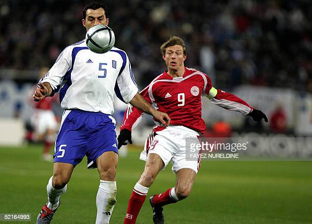 Greece's Trianos Dellas and Denmark's Dahl Jon Thomasson vie for the ball during the World Cup 2006 qualifying football game in Athens 09 February...