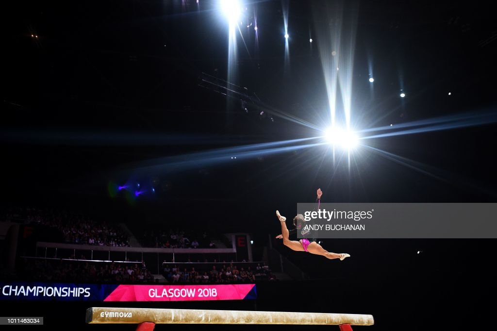 TOPSHOT - Greece's Vasiliki Millousi competes in the women's beam final of the artistic gymnastics at the SSE Hydro during the 2018 European Championships in Glasgow on August 5, 2018.