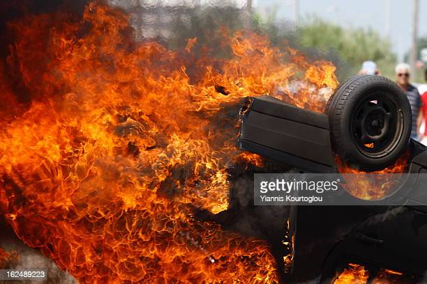 Taxi drivers set on fire a taxi during a demonstration in Thessaloniki on August 22011