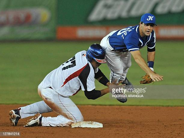 Greecian James Demetral puts out Javier Castillo from Panama during the Baseball World Cup in Panama City on 01 October 2011 AFP PHOTO/ Rodrigo...