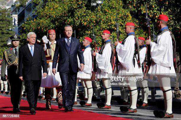 Greeck President Prokopis Pavlopoulos L and Turkey's President Recep Tayyip Erdogan during the welcome ceremony in Athens Thursday Dec 7 2017 Erdogan...