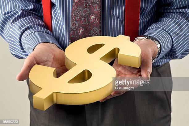 Greedy banker holds dollar symbol of wealth