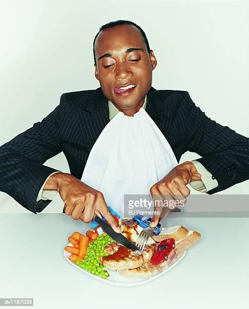 Greedy Businessman Eating a Big Meal