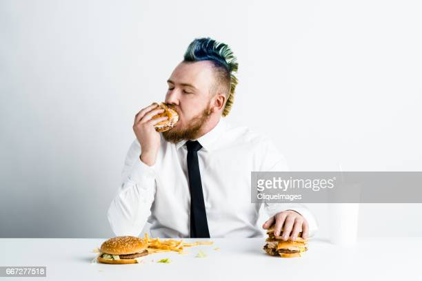 Greedy junk food lover having meal
