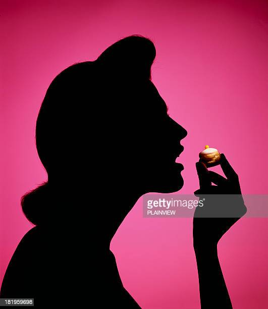 greedy woman - shadow puppet stock photos and pictures