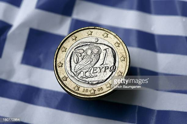 GERMANY BONN Greek 1 euro coin on the Greek national flag