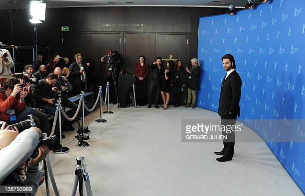 Greek actor Theo Alexander poses during a photo call for the film 'Meteora' on February 12 2012 in Berlin in competition at the Berlinale Film...