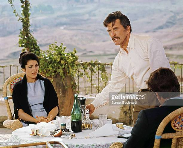 Greek actress Irene Papas American actors Kirk Douglas and Alex Cord on the set of The Brotherhood directed by Martin Ritt