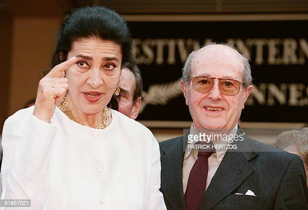 Greek actress Irene Papas gestures as she stands next to Portuguese director Manoel de Oliveira19 May at the top of the steps of the Palais des...