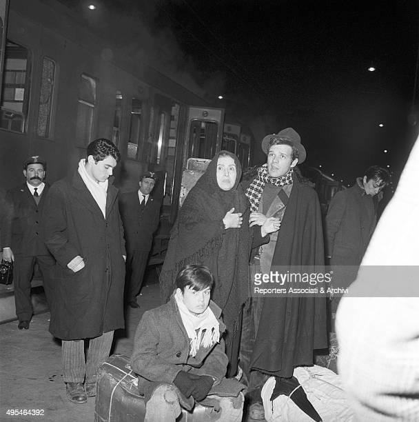 Greek actress Katina Paxinou French actors Alain Delon and Max Cartier and Italian actors Renato Salvatori and Rocco Vidolazzi at the train station...