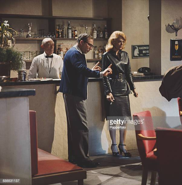 Greek actress Melina Mercouri pictured in character as Magda with director Carl Foreman on the set of the film 'The Victors' in 1962