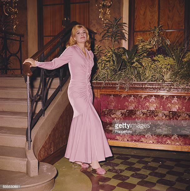 Greek actress Melina Mercouri pictured wearing a full length pink dress in London in 1962