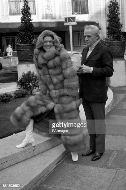 Greek actress Melina Mercouri wears a long fur coat as, with her husband, Jules Dassin, she enjoys the Spring sunshune in Park Lane.