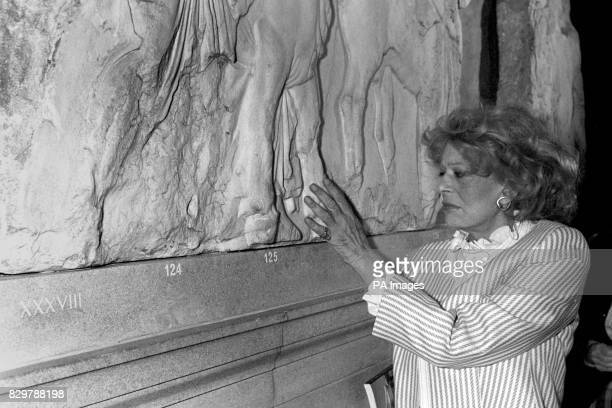 Greek actress Melina Mercouri who is Greek Minister for Culture and Sciences touches the Elgin Marbles She is on a four day visit to London and is...