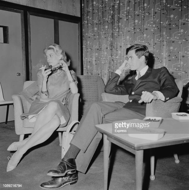Greek actress singer and politician Melina Mercouri with American actor and singer Anthony Perkins at Heathrow Airport to film American drama film...