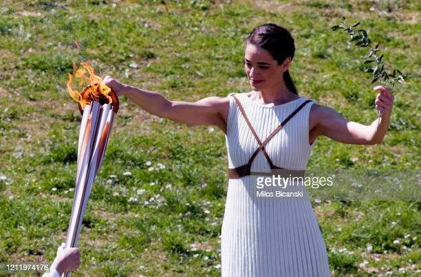 Greek actress Xanthi Georgiou playing the role of High Priestess passes the flame to the first torchbearer during the opening of the Olympic flame...