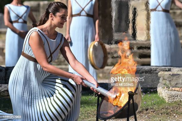 Greek actress Xanthi Georgiou, playing the role of the High Priestess, lights the torch during the flame lighting ceremony for the Beijing 2022...