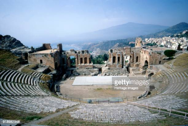 Greek Ampitheatre seashore and Mount Etna Taormina Sicily 3rd century The Greek theatre of Taormina was originally built for dramatic performances or...