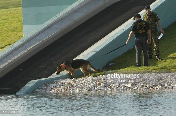 Greek antiterrorist unit member searches with a sniffer dog the Olympic CanoeKayak slalom venue during an operation named 'Clean upLocked down'...