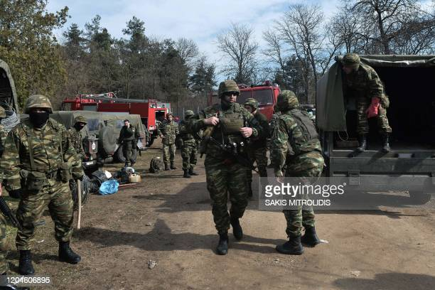 Greek army officers stand on the Greek side of the GreeceTurkey border near Kastanies on March 2 2020 Greece was on a state of alert on March 1 2020...