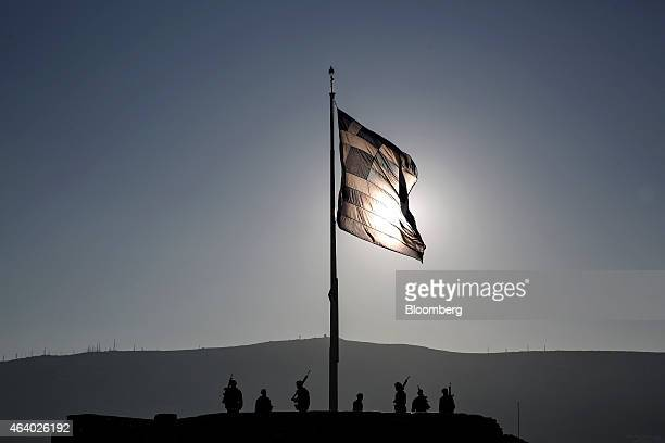 Greek army soldiers perform ceremonial duties after raising of their national flag on Acropolis Hill in Athens Greece on Saturday Feb 21 2015 Greece...