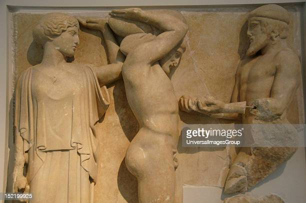 Greek Art 5th century BC Metope depicting the eleventh labor of Hercules holding the sky aided by Athena as Atlas holding the golden apples from the...